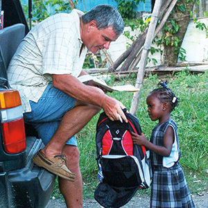 Brother_Bernie_Spitzley_Jamaica_with_child.jpg