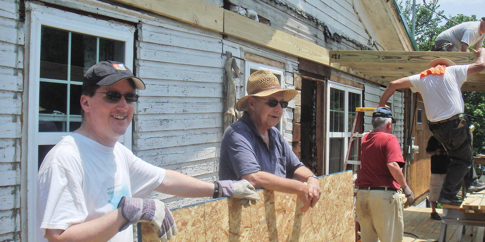 Father Adam and a crew of volunteers help to repair a local home in Gassaway, West Virginia.