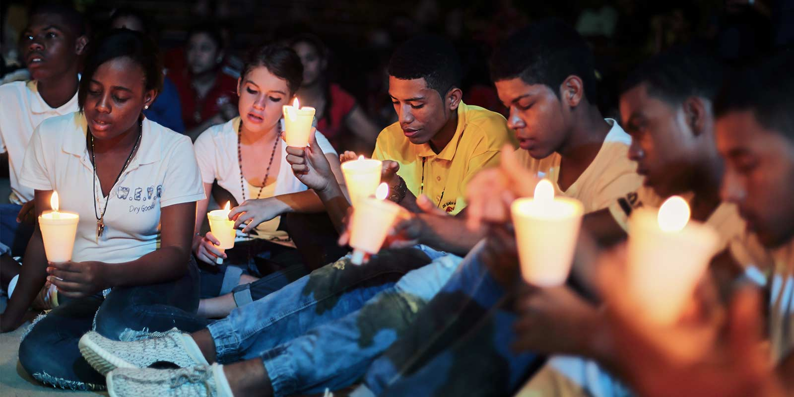 Young adults with candles
