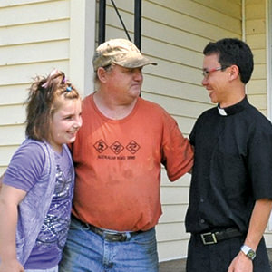 Father_Thien_at_Foot_Pantry_with_residents.jpg