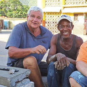 Brother Bernie visiting with a local resident in Jamaica