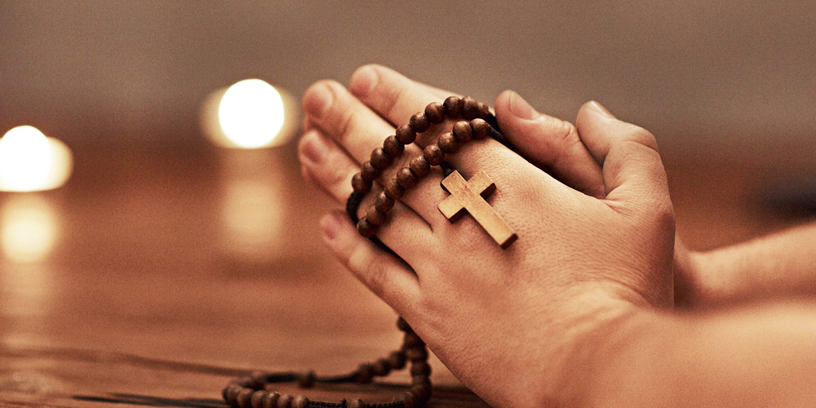 Hands in prayer with rosary