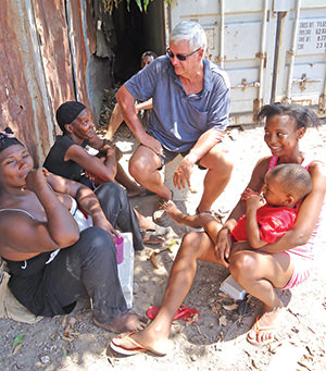 Brother Bernie visiting with locals in Jamaica